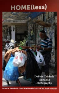 Color Photograph of a homeless man with a shopping cart of plastic bags full of empty bottles and his belongings, outside on a street in Tel Aviv, Israel