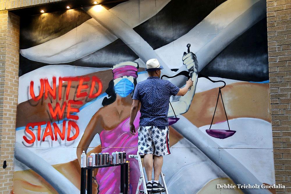 Man Spray Painting Mural, United We stand, 2020, Soho , New York City